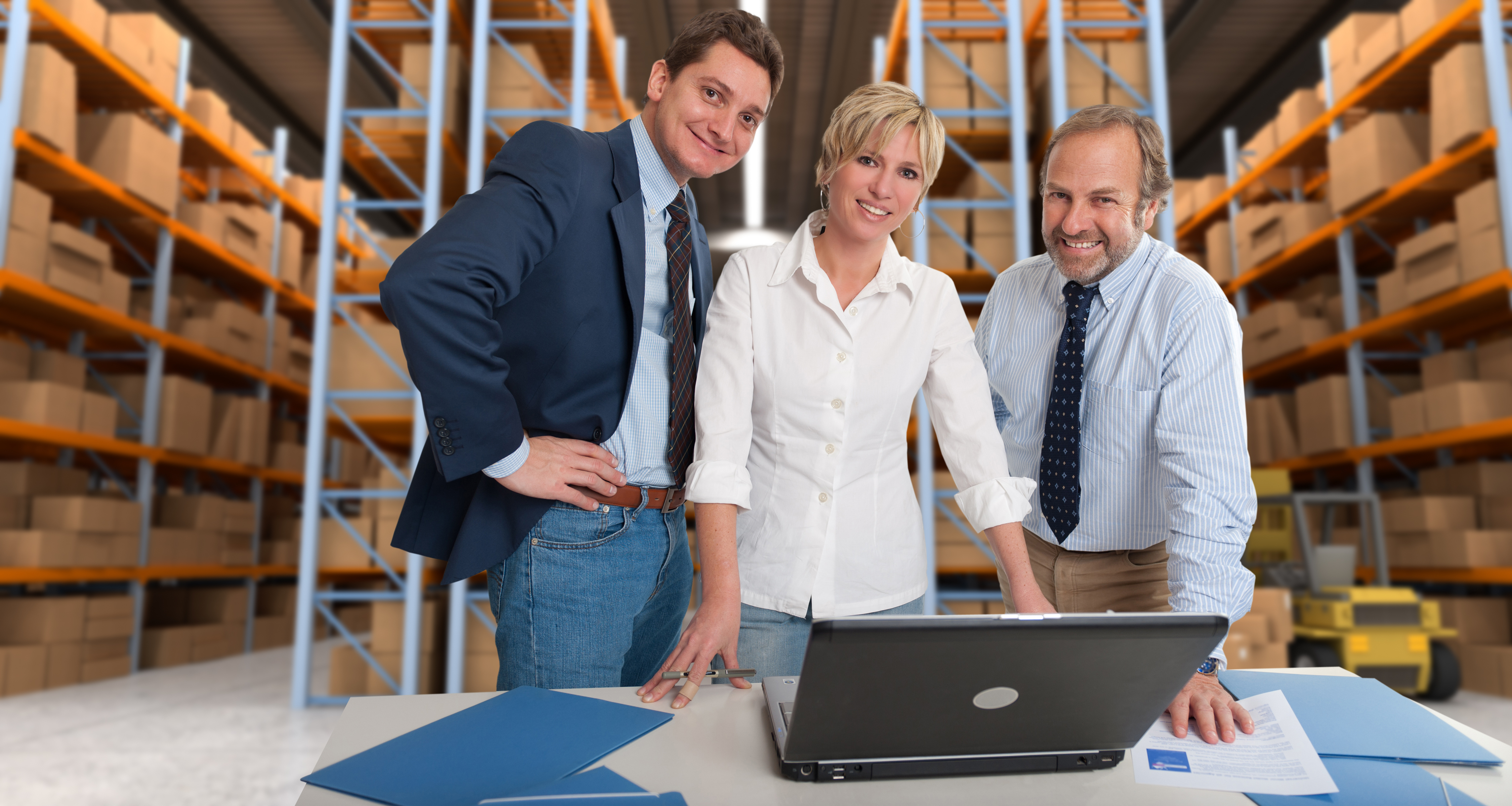 Business team with a storage warehouse at the background | Capitol Hill Offices